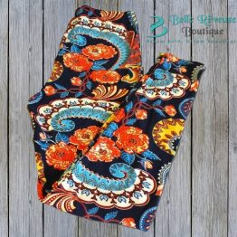 yellow, orange & navy blue paisley leggings on wood