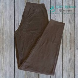 dark brown leggings on wood background