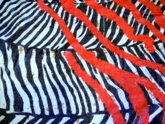 Zebra Print and Red Scarf Closeup