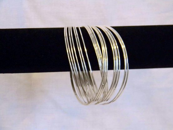 different bangles linked silver bangles hanging